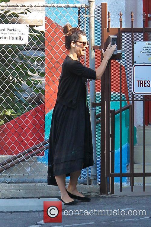 Sandra Bullock drops her son off at school