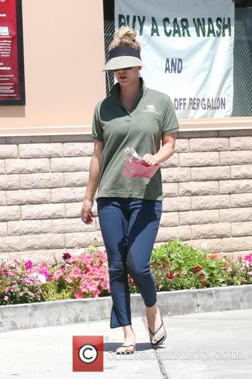 Kaley Cuoco stops at gas station