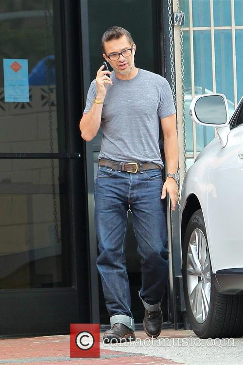 Olivier Martinez seen on his cell phone
