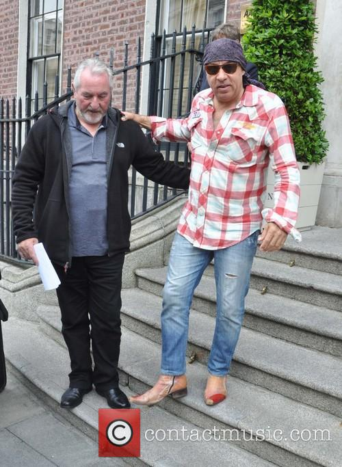 Bruce Springsteen greets fans outside the posh Merrion...