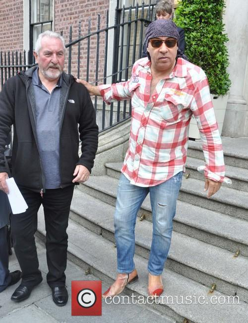 Bruce Springsteen greets fans outside the posh Merrion Hotel