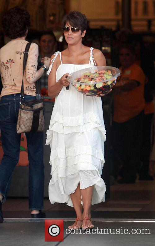 Newlywed Halle Berry picks up a prepackaged fruit...