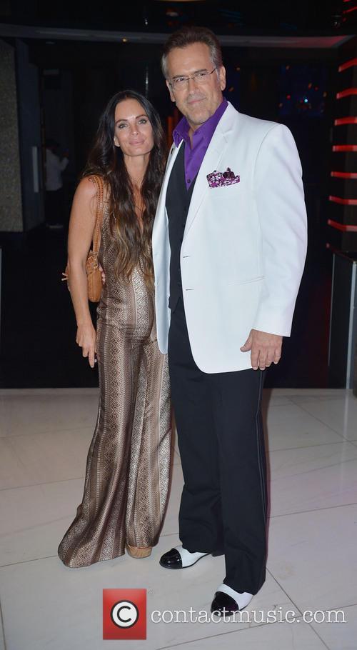 Gabrielle Anwar and Bruce Campbell 6