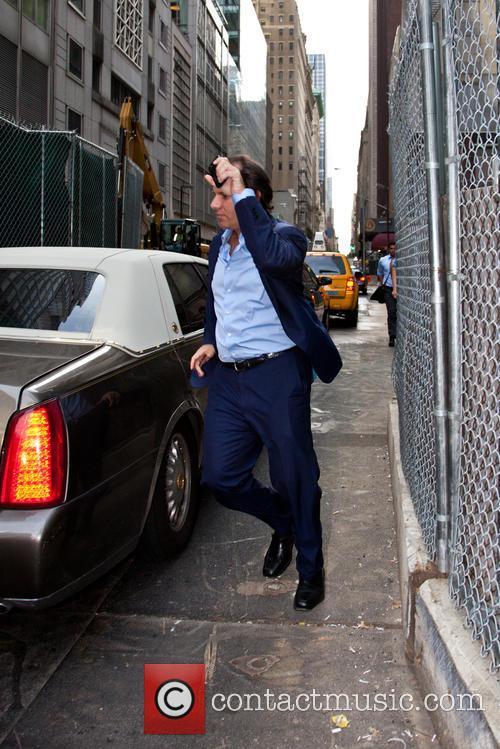 Andrew Silverman avoids the press as he leaves...