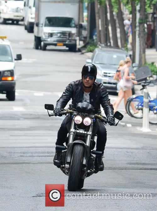Justin Theroux on his motorcycle