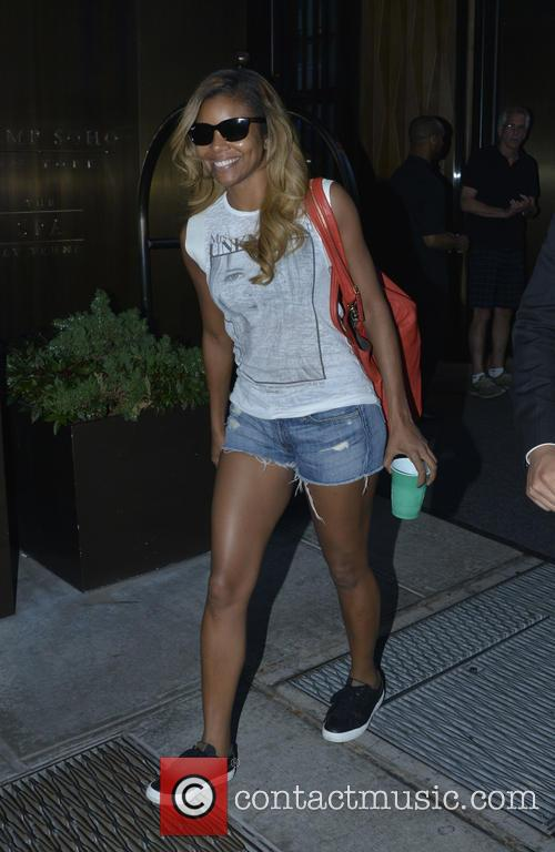 A newly blonde Gabrielle Union is all smiles...