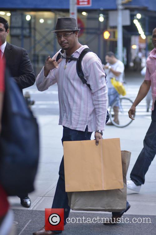 Terrance Howard returning to his Manhattan hotel