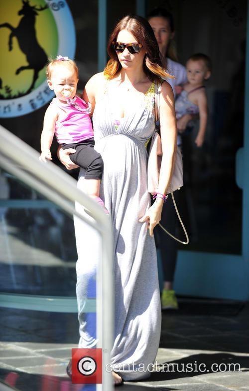 A pregnant Lisa Stelly leaves a children's gym