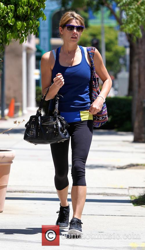 Ashley Greene shows off her buff arms