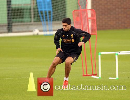 Troubled Liverpool FC player Luis Suarez takes part...