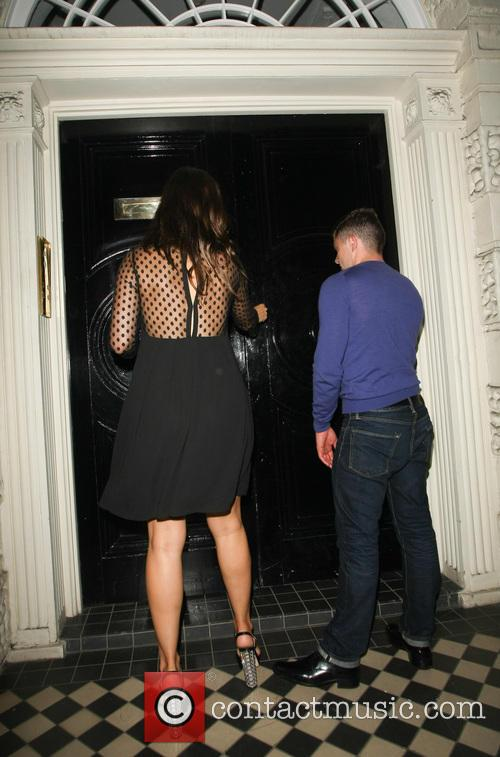 Kelly Brook arrives home with a male friend...