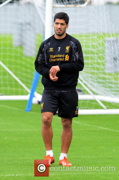 Luis Suarez trains alone at Liverpool's training ground