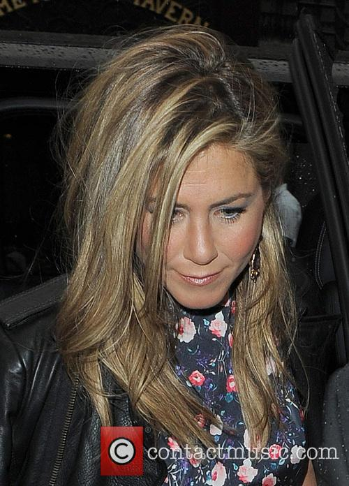 Jennifer Aniston arriving at Wahaca restaurant, flanked by...