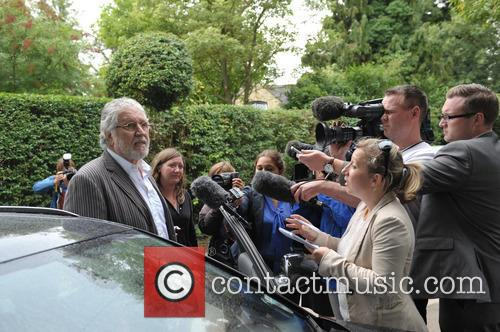 Dave Lee Travis charged