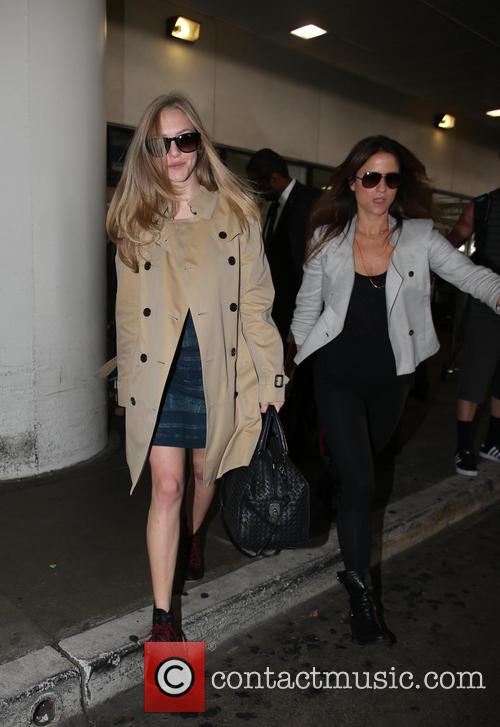Amanda Seyfried arrives back into LAX