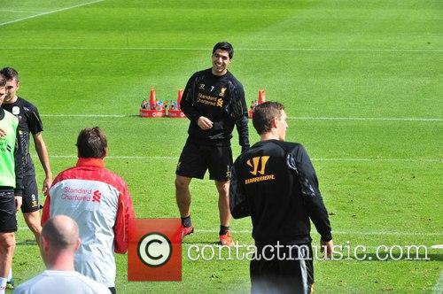 Luis Suarez trains with the first team