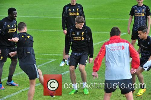Luis Suarez trains with first team