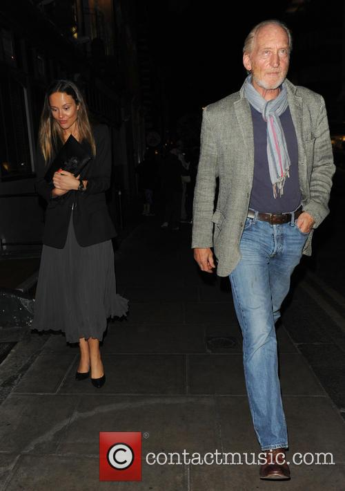 Charles Dance and mystery woman leave a nightclub