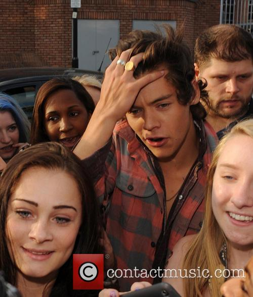 One Direction greet their fans outside their studios