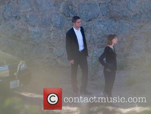 Robert Pattinson and Mia Wasikowska 9