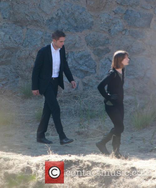 Robert Pattinson and Mia Wasikowska 10