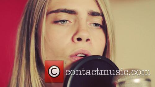 Cara Delevingne and Will Heard performing in the...