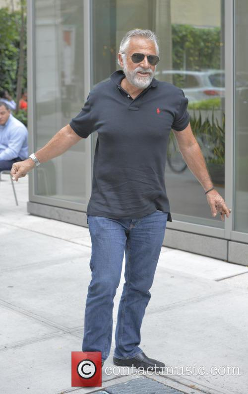 Jonathan Goldsmith smokes a cigar while out and...