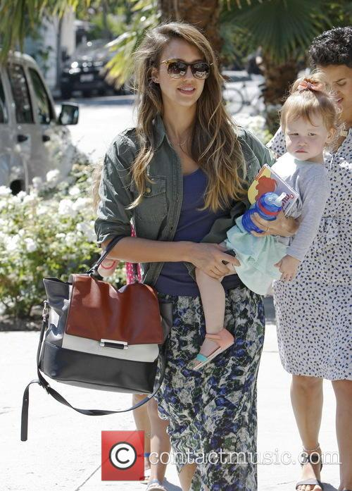 Jessica Alba Carries Her Daughter