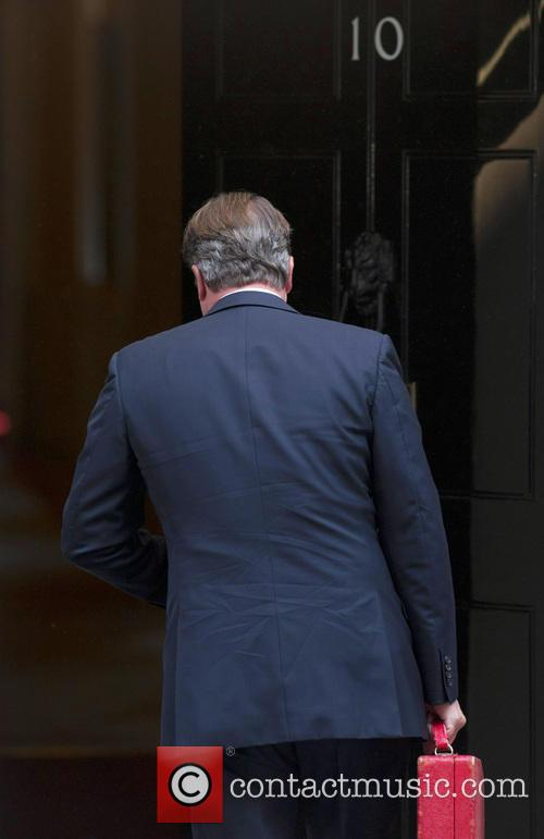 Prime Minister David Cameron arrives at 10 Downing...