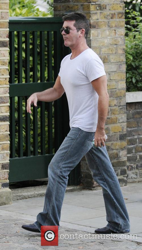 Simon Cowell Walking