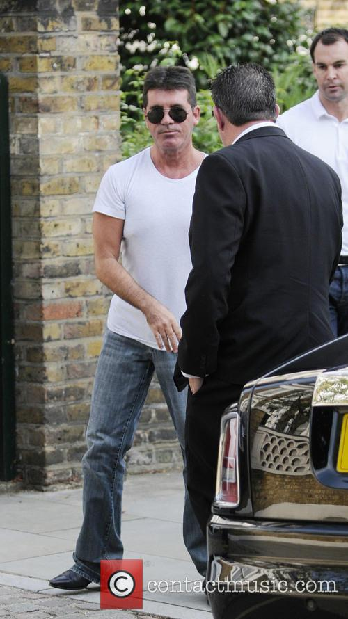 Simon Cowell and Lauren Silverman arrive home