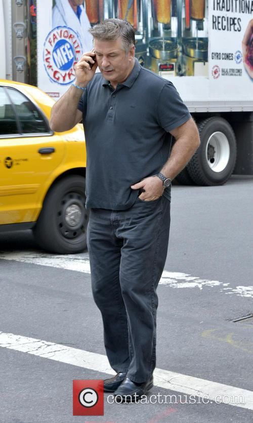 New parents Alec Baldwin and wife Hilaria stroll separately in Manhattan