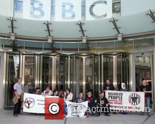 DPAC stage a sitdown protest outside the BBC