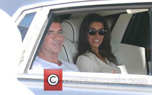 Simon Cowell and Mezhgan Hussainy 7