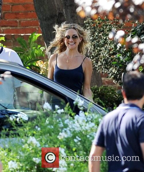 """Actress Kate Hudson taking pictures on her last day on set with the cast and crew of """"Wish I Was Here"""""""