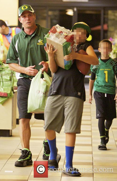 Jason Wiles and his son leaving Gelson's