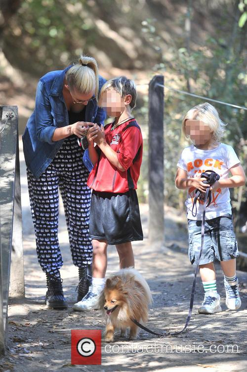 Kingston and Zuma Rossdale take their pet dog...