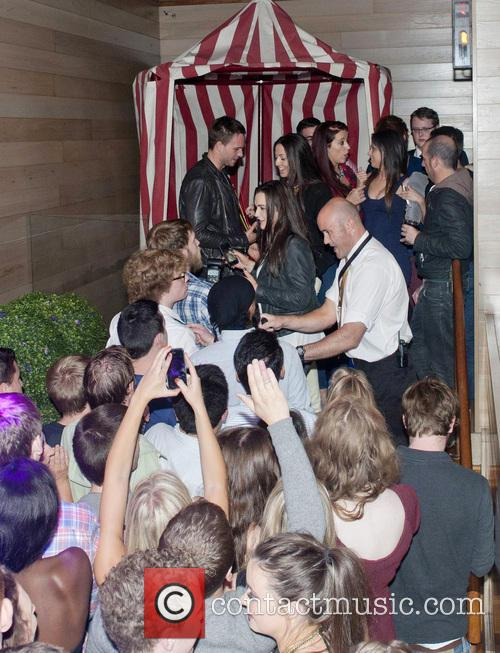 Patrick J. Adams parties with fans in the...