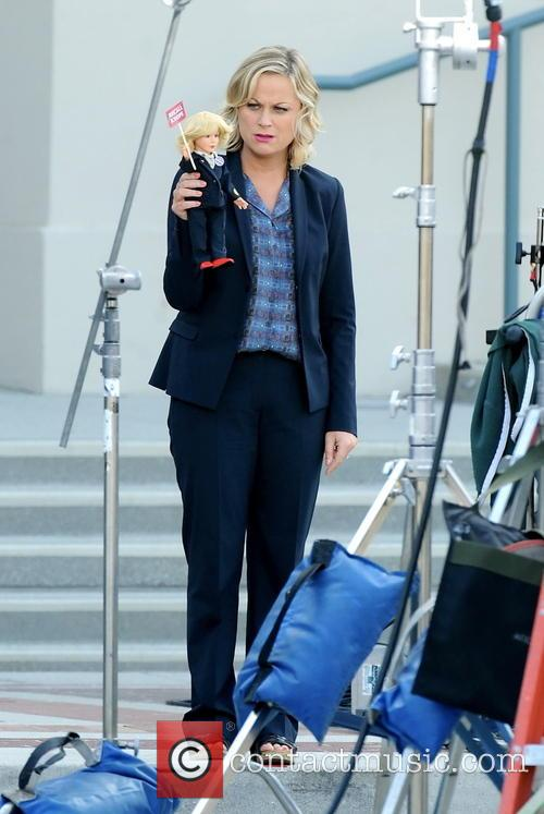 Amy Poehler giggling on the set of her...