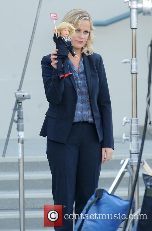 Amy Poehler giggling on the set of her TV show 'Parks and Recreation'
