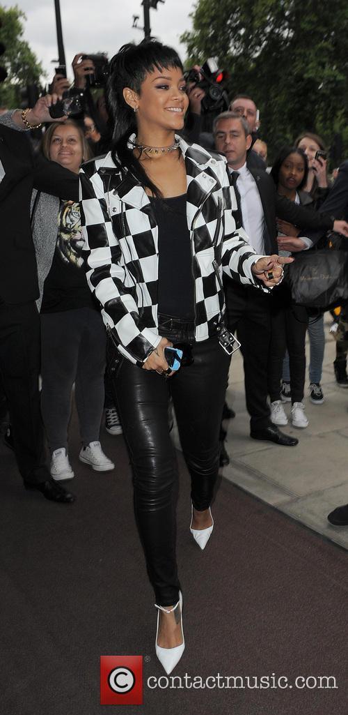 Rihanna arrives back at her hotel, having filmed...