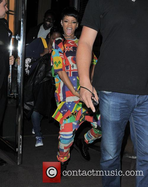Rihanna pictured leaving her hotel in a happy...