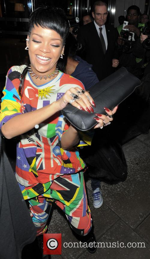 Rihanna pictured leaving her hotel in a happy and playful mood in London