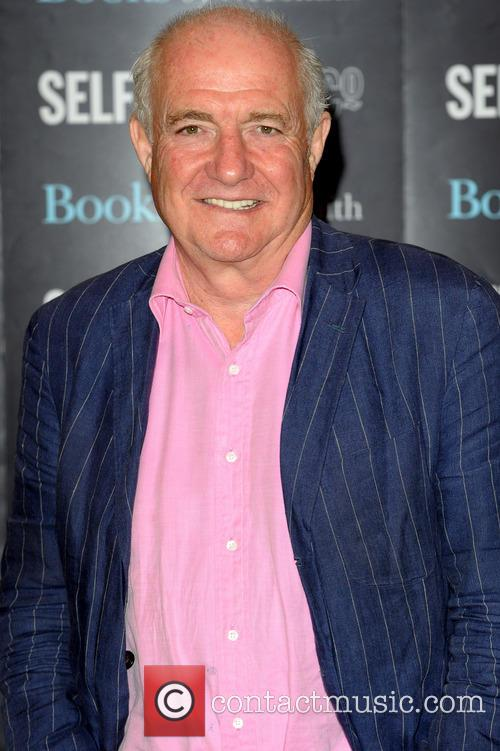 Chef Rick Stein signs copies of his autobiography...