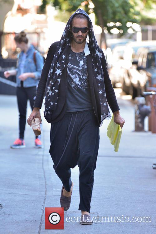 Russell Brand leaving a coffee shop