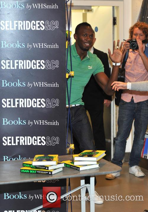 Usain Bolt signs his autobiography 'Faster Than Lightning'