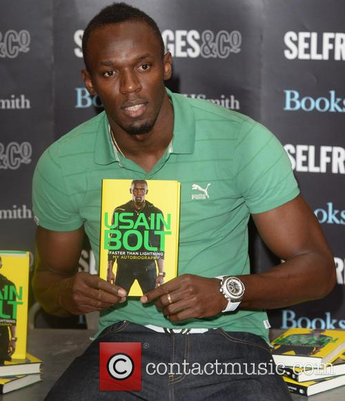 Usain Bolt signs his official autobiography 'Faster Than...