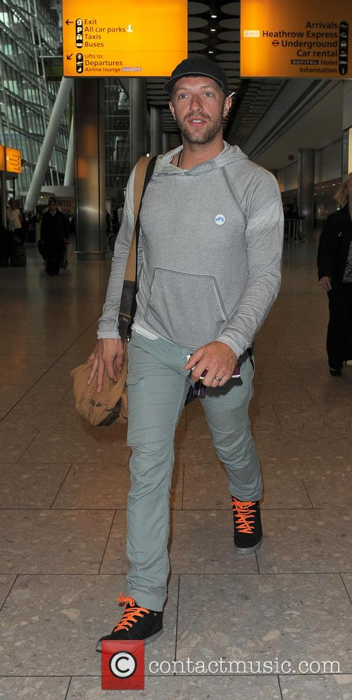 Chris Martin arriving at Heathrow Airport on a...
