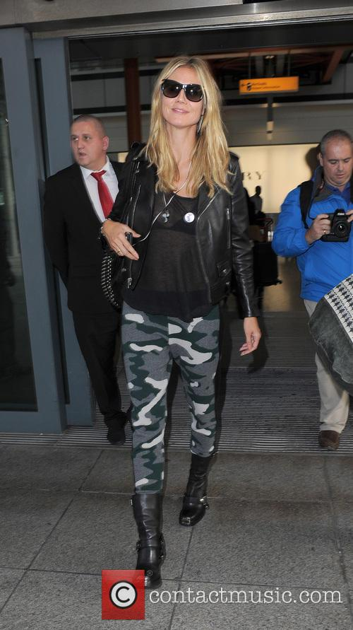 Heidi Klum arriving at Heathrow Airport on a flight from Los Angeles