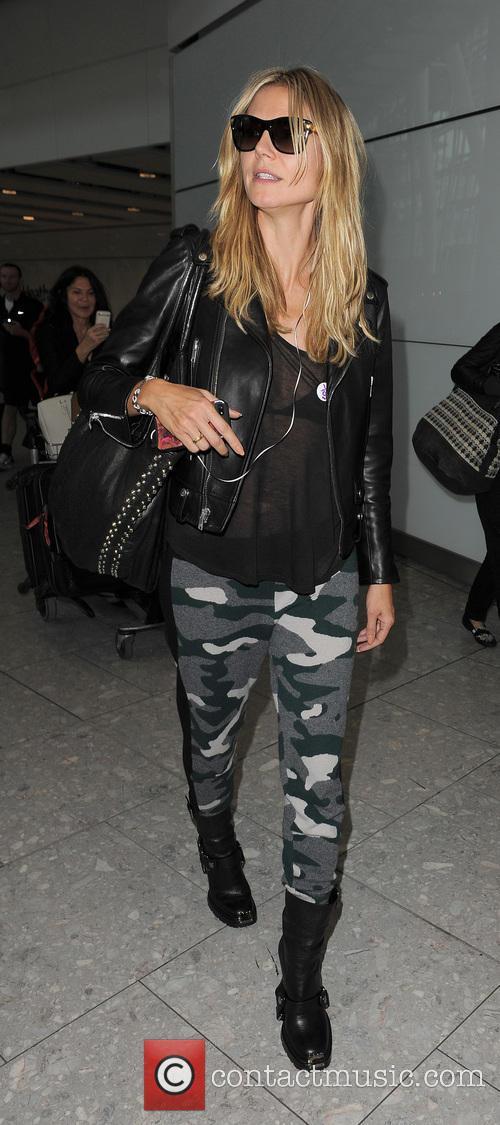 Heidi Klum arriving at Heathrow Airport on a flight from Los Angeles